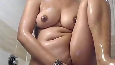 Hot Indian housewife in bathroom