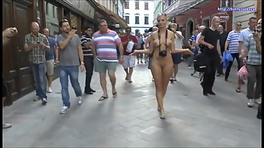 Sexy blonde walks naked through the streets of the old city